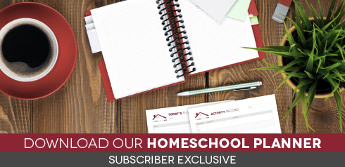 Overhead view of desktop with planner pages and text Download our Homeschool Planner - Subscriber Exclusive