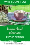 Pink coffee cup with green and white checked napkin on a table outside with a basket of flowers and green grass yard in the background with text Why I don't Do Homeschool Planning in the Spring TheHomeSchoolMom