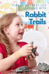 happy girl with modeling clay in hands and text Pursue interest-led learning with rabbit trails