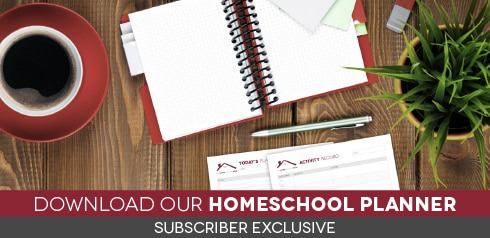 Overhead image of planning pages, organizer, coffee cup, pen, and plant on a wood surface with text Download our homeschool planner (subscriber exclusive)